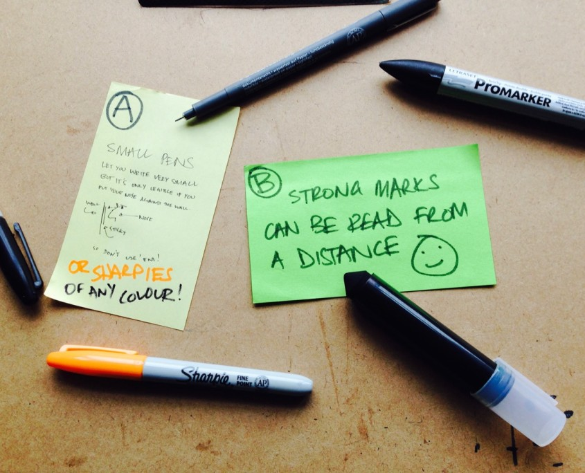 Sticky Notes in portrait and landscape orientation with various types of pens