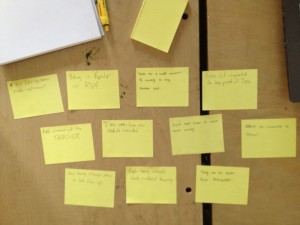 Ryan Shriver's Design Class Sticky Notes, posted on a desk.